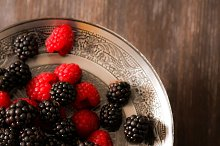 raspberries and blueberries on a plate in the Oriental style