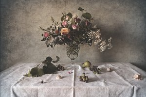 Still life with flowers and grape