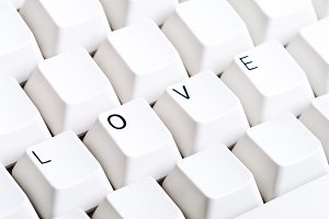Word LOVE on computer board.