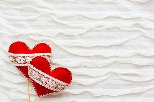 Two felt hearts. Love symbol.