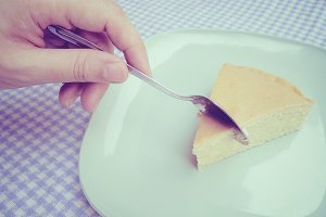 Slice piece of butter cake by spoon