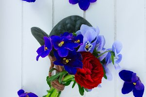 Posy of violets, pansies and ranunculus
