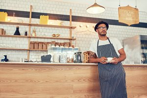 Cafe owner standing at counter
