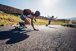 Young people skateboarding outdoors