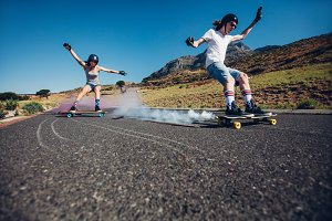 Young people longboarding