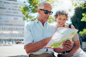 Senior couple looking at city map