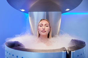 Beautiful young woman in cryosauna