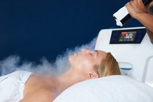 Woman getting local cryotherapy