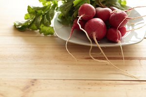 Radishes on a white plate