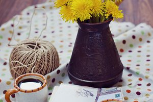 Espresso cup and dandelions