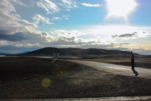 Icelandic mountain landscape with road and alone man