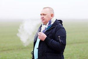 Smoking mature man