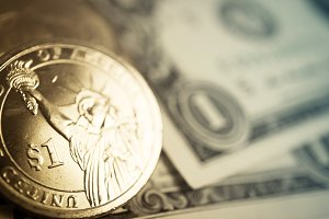 dollar coins and banknotes