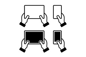 Hands holding smart phone and tablet