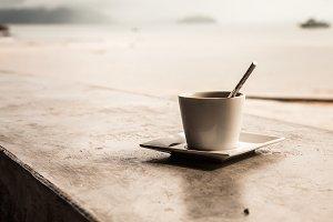 Hot coffee on tropical beach