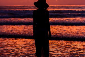 Silhouette lonely woman on sunset