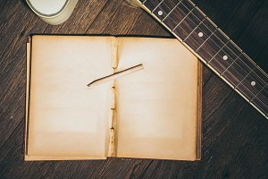 Old blank book with guitar