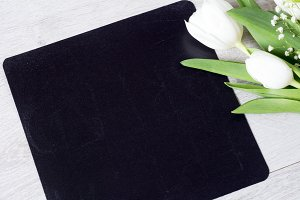 Chalkboard and bouquet of flowers