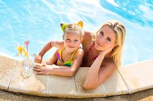 Happy Mothers day. Girl, mom, pool.