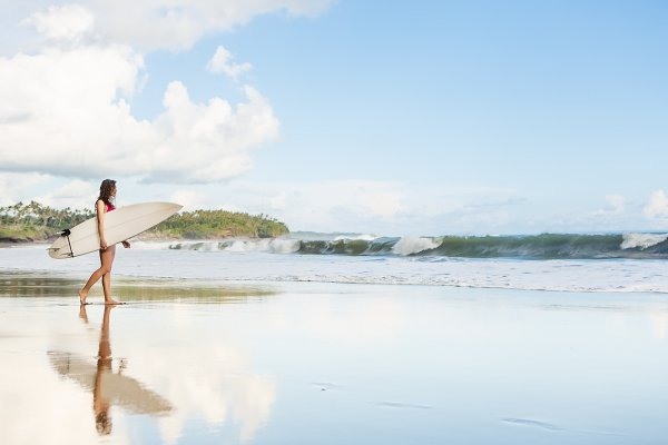 Beautiful girl with surf at beach.