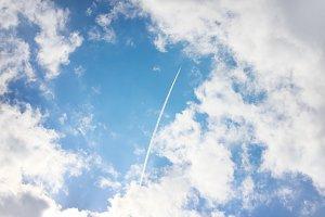 Airplane high in blue sky