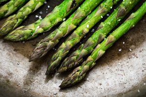 Close-up of asparagus on frying pan