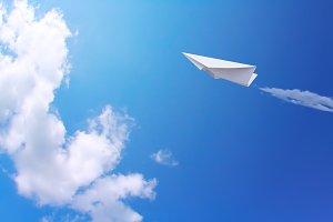 Paper plane in blue sky
