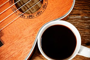 coffee cup and Ukulele on wooden tab