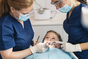 Dentists with a patient.