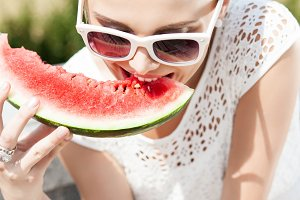 Beautiful girl eat watermelon.