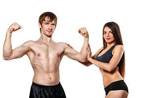 Girl and man posing athletes