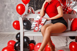 Girl with balloons and gift.