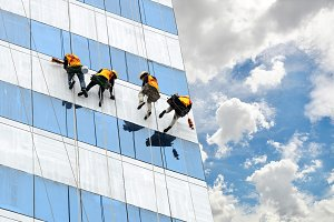 workers cleaning windows