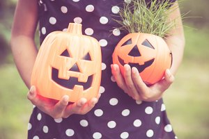 Girl holding pumpkin lantern