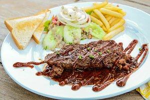 steaks set in dish