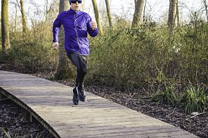 Man running in a promenade outdoors. Man is training