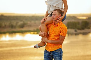 Man carrying girl on piggyback.