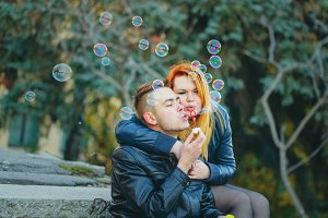 Couple starts soap bubbles