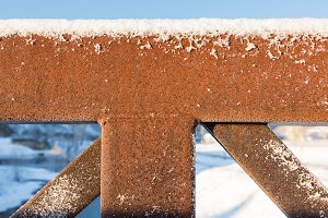 Rusty railing on bridge