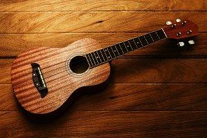 ukulele guitar on brown wood