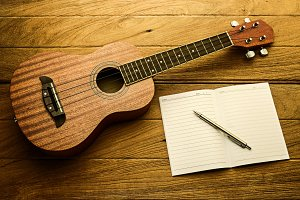 ukulele guitar with blank notebook