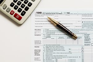 USA Tax form 1040 being completed