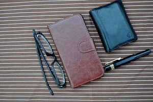 glasses, pen, wallet and mobil