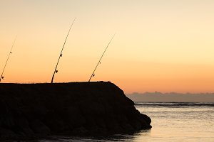 Fishing rods waiting for a catch