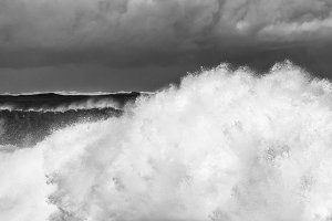 Stormy sea surf against sandy beach