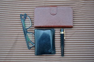 glasses, wallet, pen and mobil