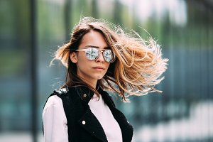 Street fashion concept. Young beautiful model in the city. Beautiful blonde woman wearing sunglasses