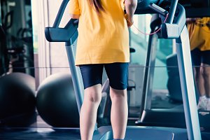 Woman in yellow shirt in fitness