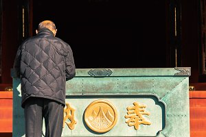 Old man in Japanese shinto temple