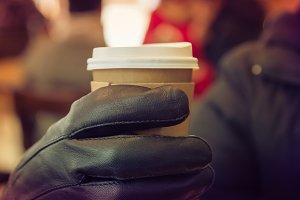 Coffee in man holding
